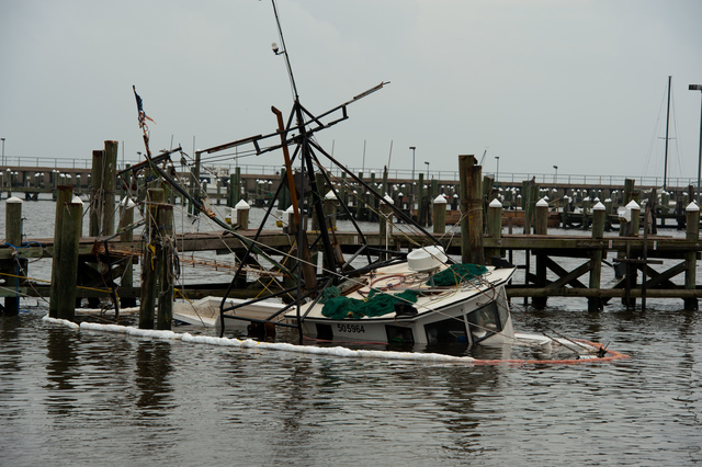 Hurricane/Tropical Storm - Pass Christian, Miss. , Aug. 31, 2012 -- This shrimp boat was sunk at the pier by Hurricane Isaac. State, local and federal officials are assessing the damage from Isaac all across Mississippi.  FEMA/Tim Burkitt