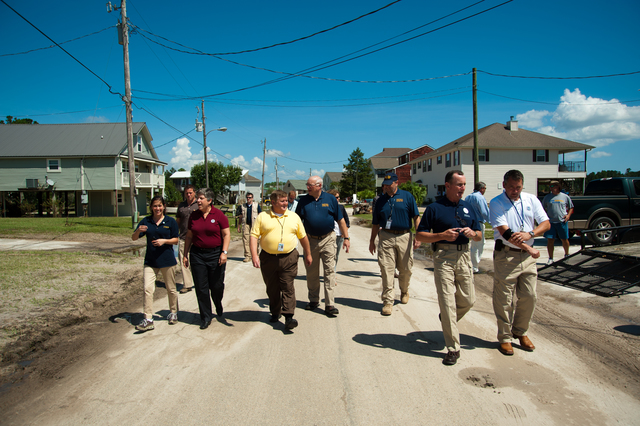 Flooding ^ Hurricane/Tropical Storm - Kiln, Miss. , Sep. 2, 2012 -- Department of Homeland Security Secretary Napolitano participates in a walking tour of an area flooded by rains from Hurricane Isaac. Federal Coordinating Officer Terry Quarles (blue shirt on right), Waveland Mayor David Garcia (yellow shirt), and Mississippi Emergency Management Agency (MEMA) Director Robert Latham (center), also viewed the area.  FEMA/Tim Burkitt