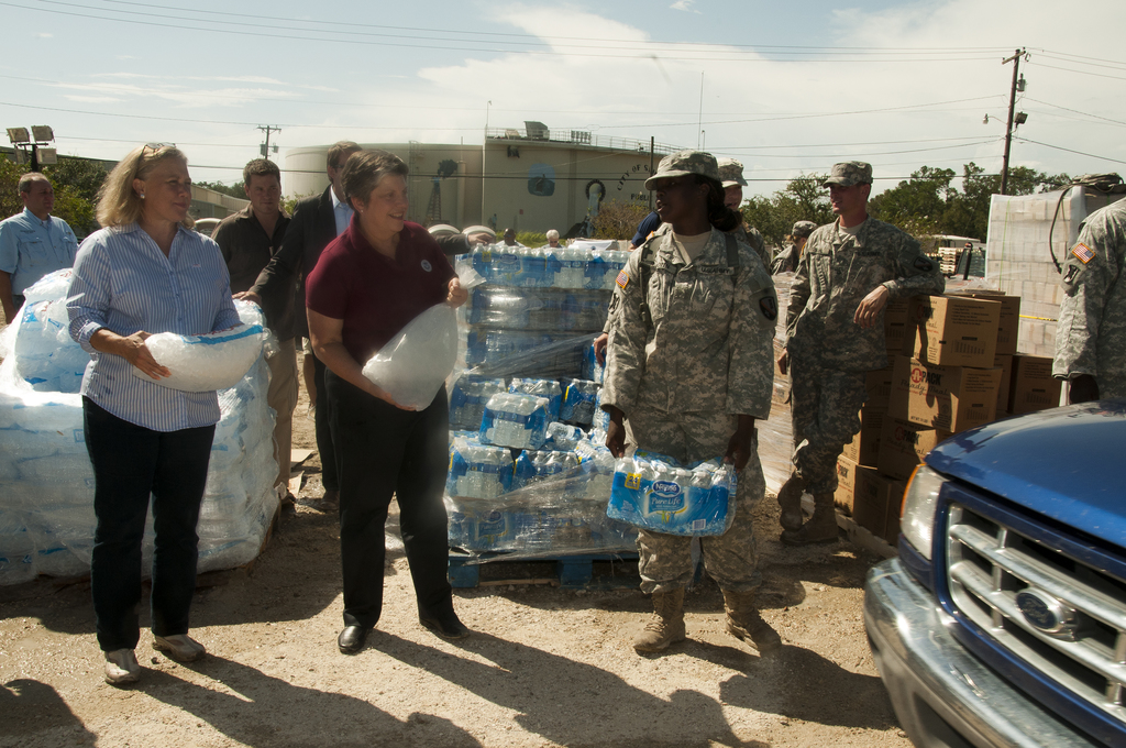 Flooding ^ Hurricane/Tropical Storm ^ Severe Storm - Slidell, La. , Sep. 2, 2012 -- DHS Sec. Janet Napolitano along with Sen. Mary Landrieu (D-La. ) joins a member of the Louisiana National Guard in distributing ice to residents in Slidell, La. , who were affected by Hurricane Isaac.  Napolitano visited LA and MS to assess the current needs of the areas affected by Hurricane Isaac.  Napolitano has ordered FEMA to provide assistance to the affected areas.  Photo by Patsy Lynch/FEMA