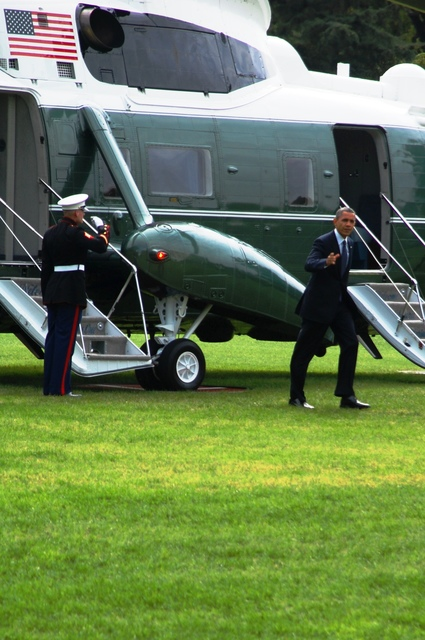 Washington, D. C. , Sep. 25, 2012 -- President Barak Obama debarks Marine One and give the gathered crowd a wave. FEMA staff were invited to take part in the president's arrival as an acknowledgement for their work during Hurricane Isaac. Photo by John Pearl