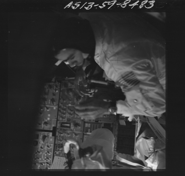 AS13-59-8483 - Apollo 13 - Apollo 13 Mission image  - Dark view of Astronaut Fred W. Haise Jr., lunar module pilot in the Command Module (CM).