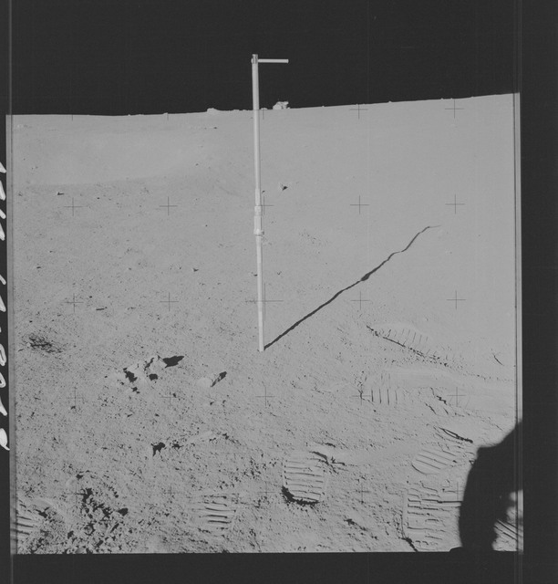 AS14-64-9048 - Apollo 14 - Apollo 14 Mission image - Pan of the Core Tube with the Lunar Module in the Background.