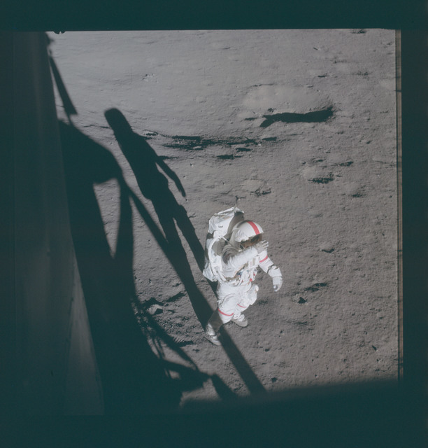 AS14-66-9229 - Apollo 14 - Apollo 14 Mission image - Astronaut Alan B. Shepard, Jr., commander, holds his right glove over his helmet visor as if to shade his eyes from the brilliant Sun.