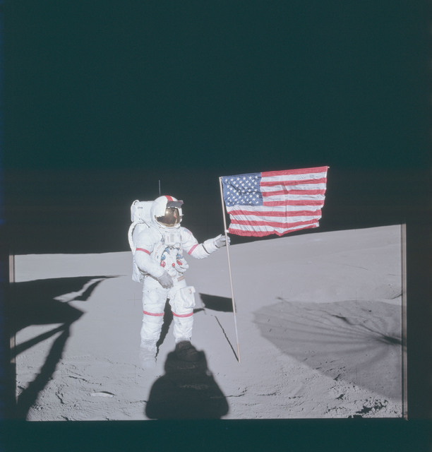 AS14-66-9231 - Apollo 14 - Apollo 14 Mission image - Astronaut Alan B. Shepard, Jr., stands by the deployed