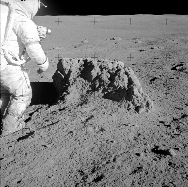 AS14-68-9414 - Apollo 14 - Apollo 14 Mission image - View of Astronaut Shepard examining a large rock.