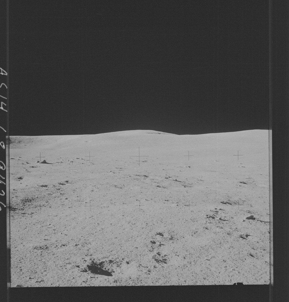 AS14-68-9426 - Apollo 14 - Apollo 14 Mission image - View of Old Nameless on the horizon as well as several small craters.