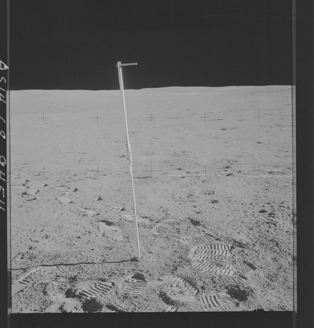AS14-68-9454 - Apollo 14 - Apollo 14 Mission image - View of a core tube inserted into the surface of a large shallow depression.