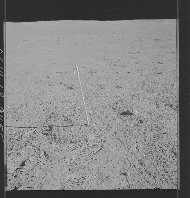 AS14-68-9455 - Apollo 14 - Apollo 14 Mission image - View of a core tube inserted into the surface of a large shallow depression.