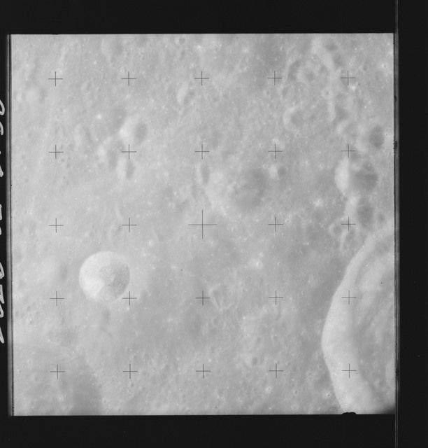 AS14-70-9704 - Apollo 14 - Apollo 14 Mission image - View of the Brunner Crater and of the Sea of Hirayama.