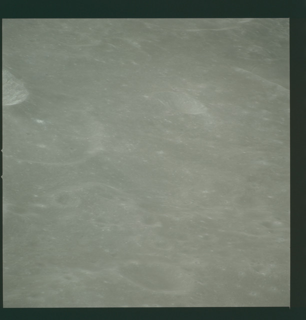 AS14-72-10011 - Apollo 14 - Apollo 14 Mission image - View of the Mare Smythii area to the north from the west edge of the Hirayama Crater.