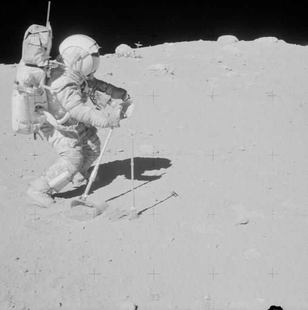AS16-106-17340 - Apollo 16 - Apollo 16 Astronaut John Young photographed collecting lunar samples
