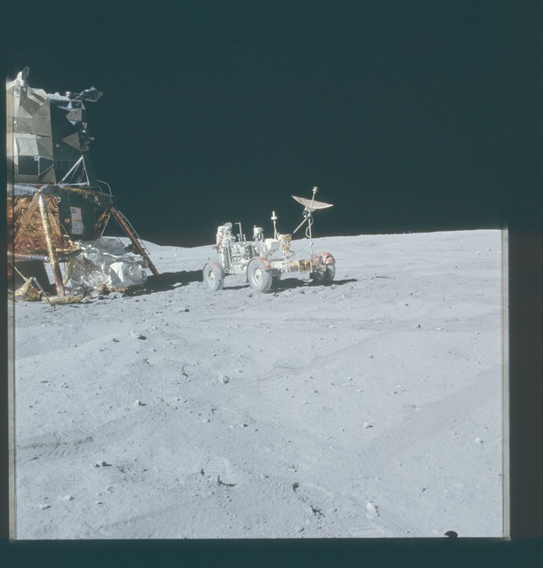 AS16-107-17437 - Apollo 16 - Apollo 16 Mission image - Partial view of the Lunar Module (LM) Orion and the Lunar Roving Vehicle (LRV)