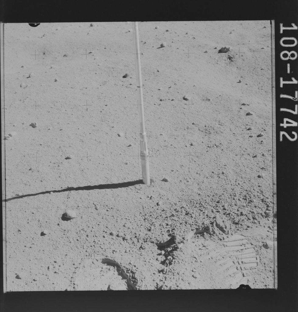 AS16-108-17742 - Apollo 16 - Apollo 16 Mission image - Station 9 and surface samples 376 (a breccia rock) and 377 soil
