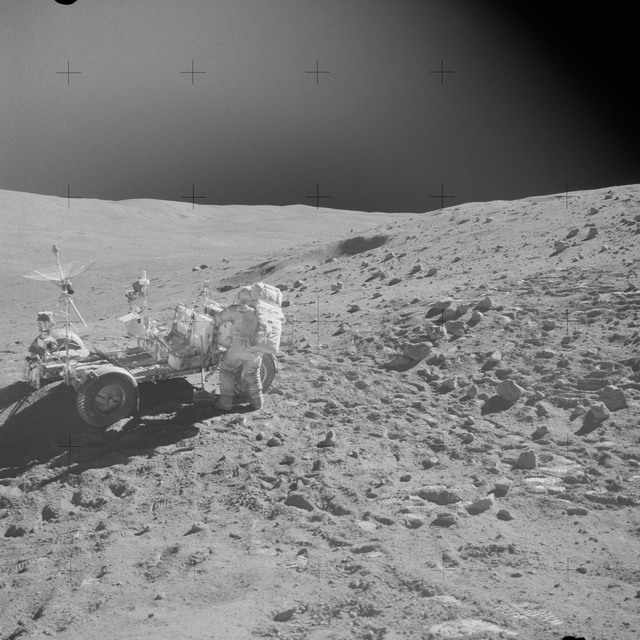 AS16-110-17961 - Apollo 16 - Apollo 16 Mission image - Astronaut John W. Young replaces tools in the Apollo Lunar Hand Tool (ALHT) carrier at the aft end of the Lunar Roving Vehicle (LRV) during the second Apollo 16 extravehicular activity (EVA-2) on the high side of Stone Mountain at the Descartes landing site.