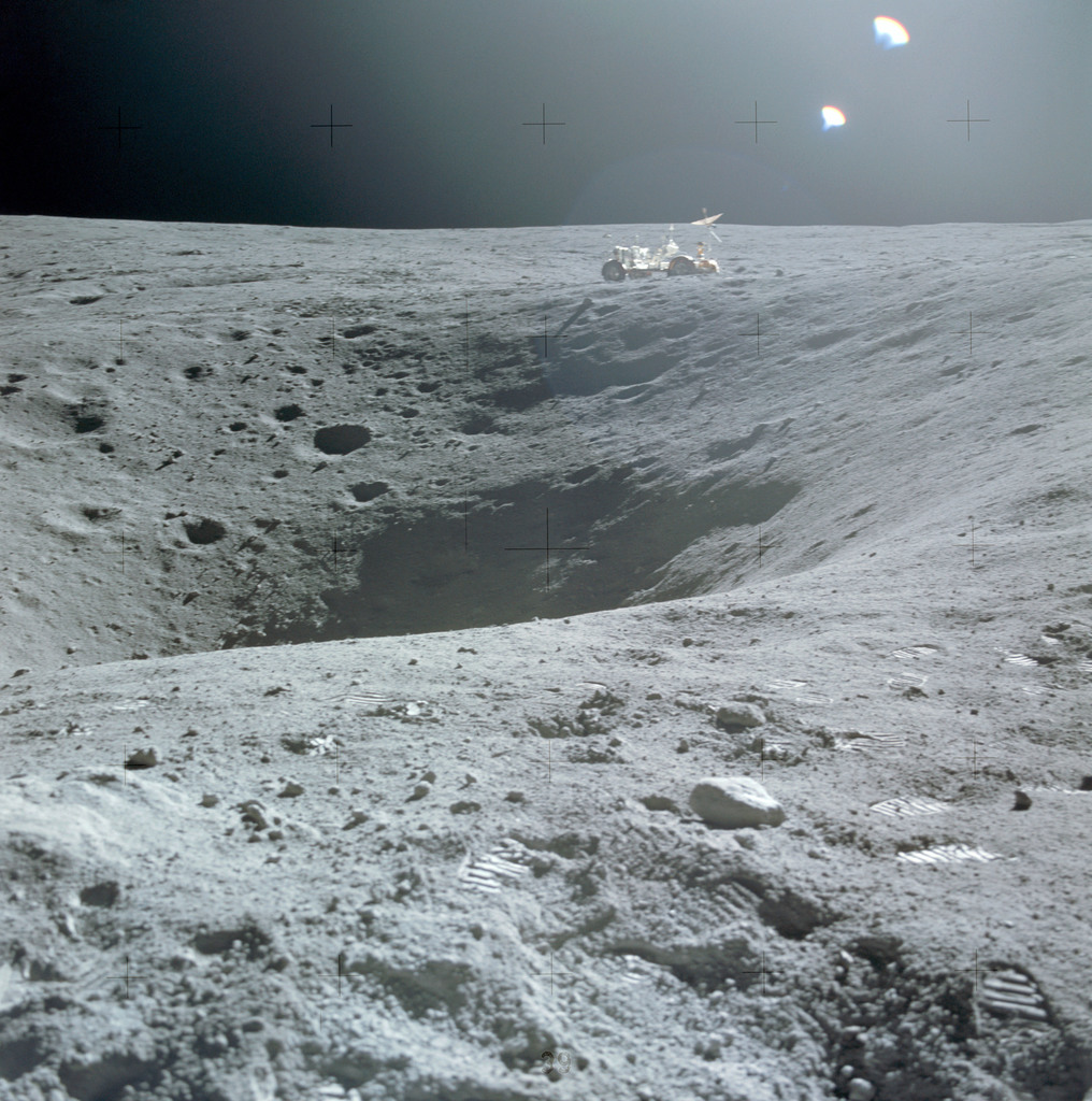 AS16-114-18422 - Apollo 16 - Apollo 16 Mission image - A view of Plum Crater, which was visited by the two Moon-exploring crew members of the Apollo 16 lunar landing mission, on their first extravehicular activity (EVA-1) traverse, April 21, 1972.