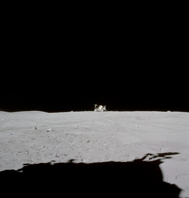 AS16-115-18559 - Apollo 16 - Apollo 16 Mission image - Astronaut John W. Young, commander of the Apollo 16 lunar landing mission, drives the Lunar Roving Vehicle (LRV) to its final parking place near the end of the third Apollo 16 extravehicular activity (EVA-3) at the Descartes landing site.