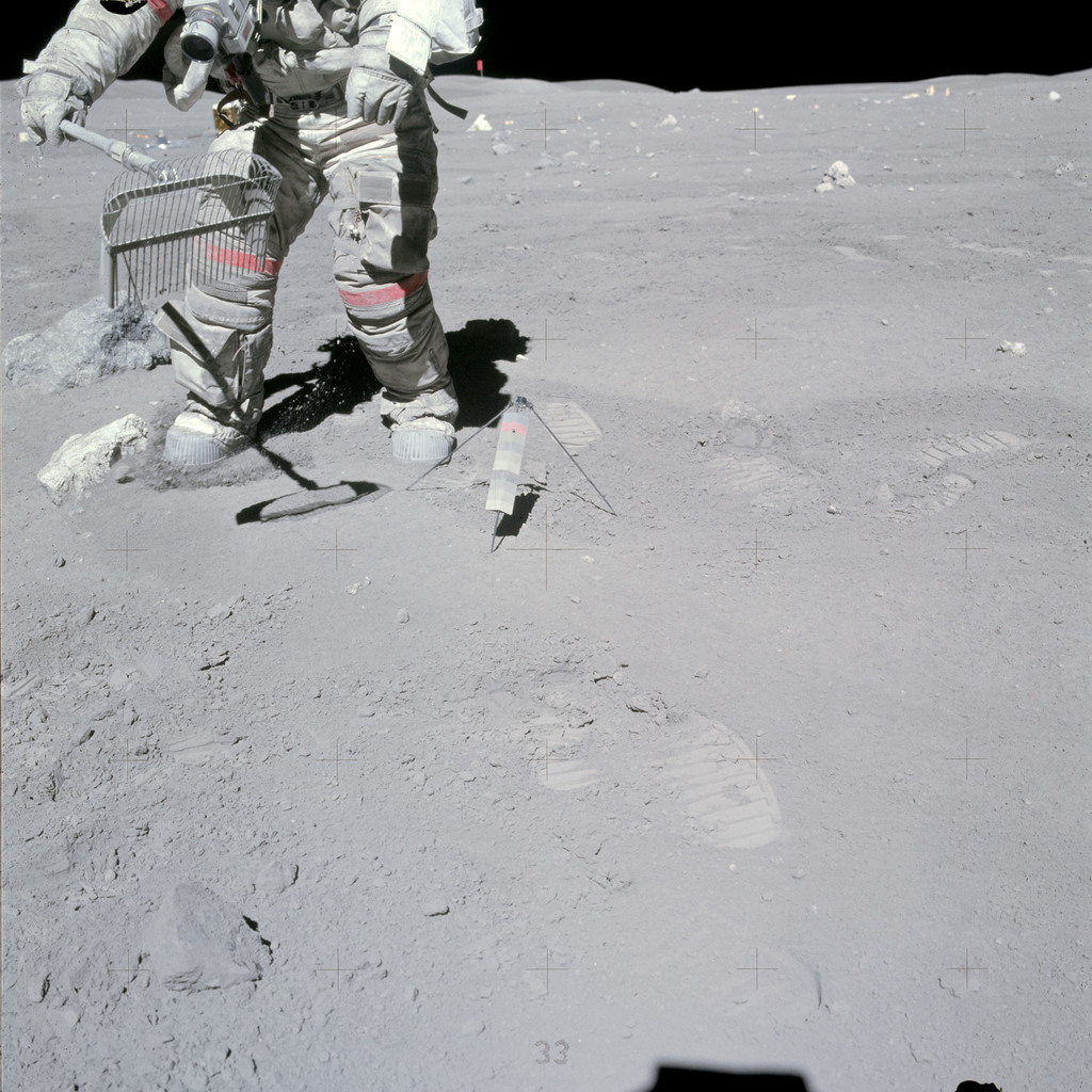 AS16-117-18826 - Apollo 16 - Apollo 16 Mission image - View of Station 10 Sample 349 Rake and 350 Soil. Astronaut John W. Young collects samples at the North Ray Crater geological site during the mission's third and final Apollo 16 extravehicular activity (EVA-3).