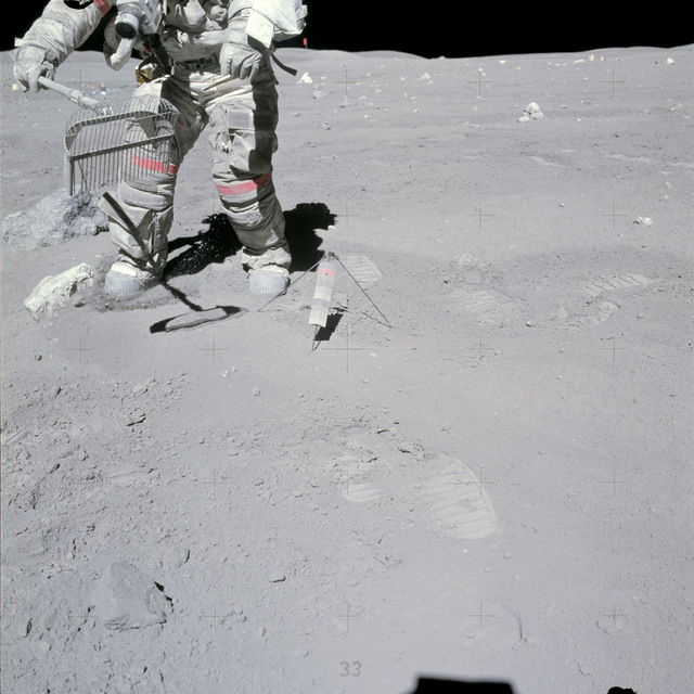 AS16-117-18826 - Apollo 16 - Apollo 16 Mission image - View of Station 10 Sample 349 Rake and 350 Soil. Astronaut John W. Young collects samples at the North Ray Crater geological site during the mission&#8217s third and final Apollo 16 extravehicular activity (EVA-3).