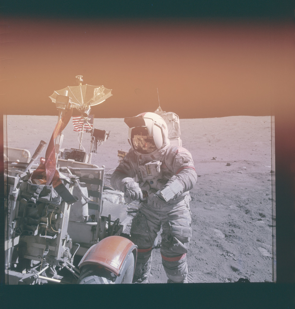 AS16-117-18852 - Apollo 16 - Apollo 16 Mission image - View of Station Lunar Module (LM) Lunar Roving Module (LRV) and Commander (CDR)