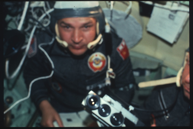 AST-03-158 - Apollo Soyuz Test Project - Apollo Soyuz Test Project, Cosmonaut Kubasov with 16-mm Camera