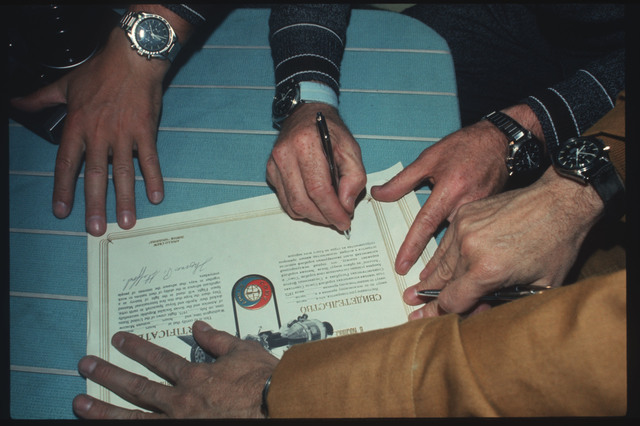 AST-03-167 - Apollo Soyuz Test Project - Apollo Soyuz Test Project, Leonov signs Docking Certificate for FAI
