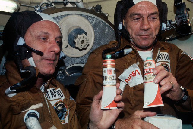 AST-03-175 - Apollo Soyuz Test Project - Apollo Soyuz Test Project, Stafford and Slayton with Soyuz Food Tubes