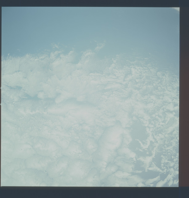 AST-20-1603 - Apollo Soyuz Test Project - Apollo Soyuz Test Project, Clouds over Pacific Ocean off California, Overexposed