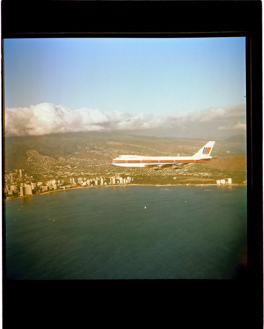 747 AIRPLANE IN FLIGHT OVER HAWAII