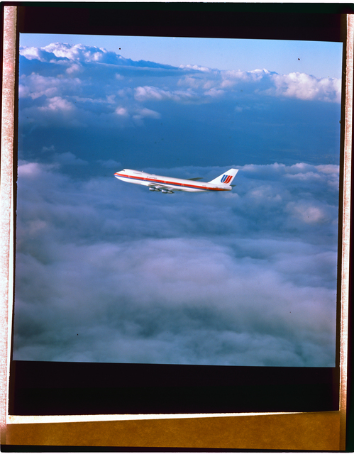 AERIAL VIEW OF 747 AIRPLANE IN CLOUDS