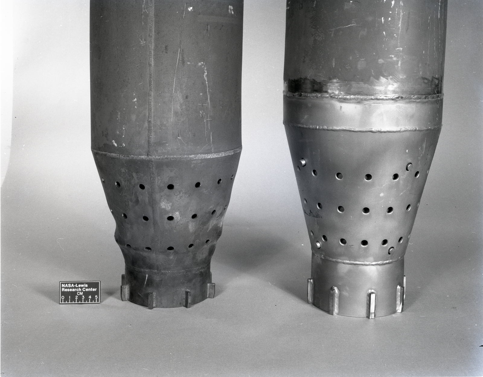 COMBUSTOR LINERS SHOWING DISTORTION OF OLD LINER AND EXISTING CONDITION OF NEW DESIGN LINER