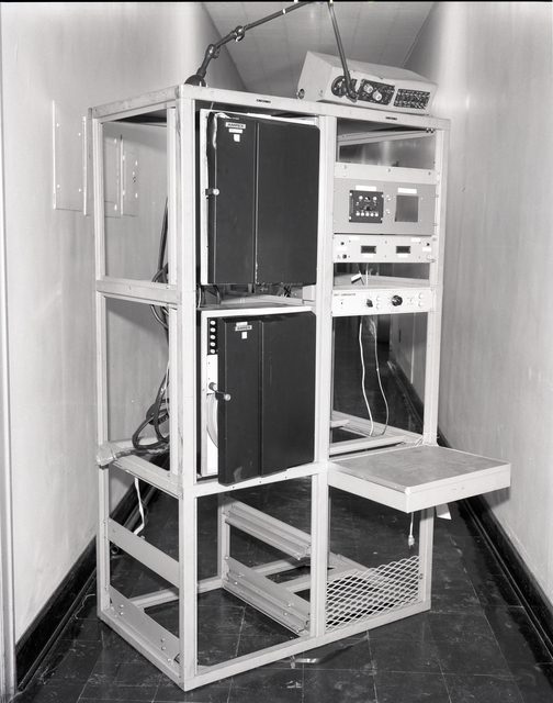 DAMAGED C-130 AIRPLANE RACK SYSTEM AND TAPE RECORDER