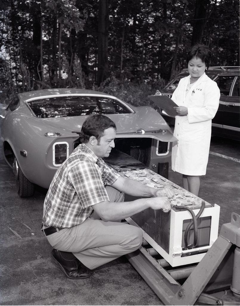 DORIS BRITTON AND JOHN EWASHINKA WITH ELECTRIC CAR BATTERY ARRAY