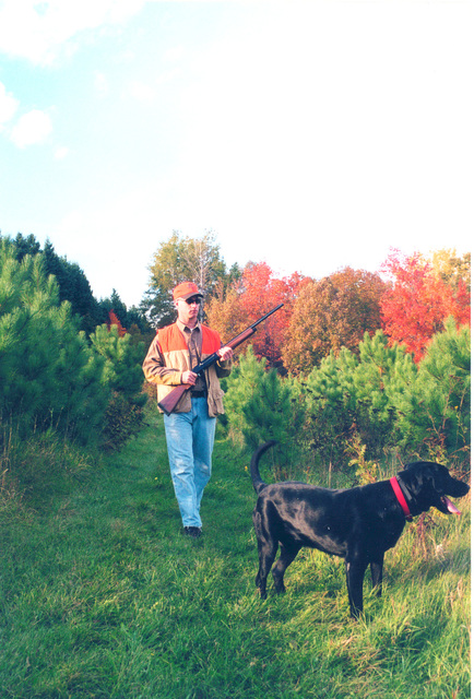 Edge of the Wilderness - A Hunter and His Dog
