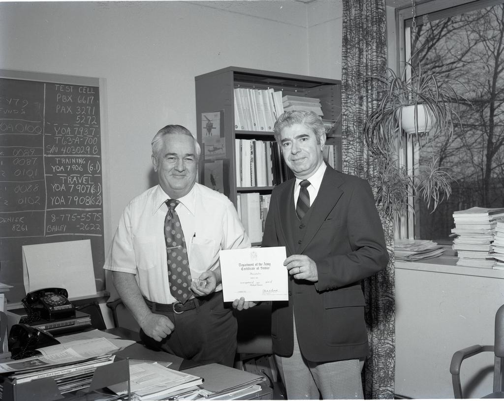 EDWARD DUNN RECEIVING HIS 20 YEAR SERVICE AWARD