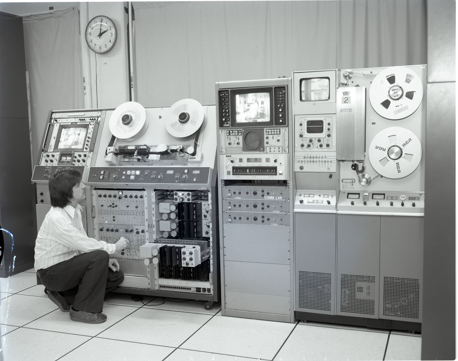 JIM ELY WITH TELEVISION TV TAPE MACHINES AND SCREENS