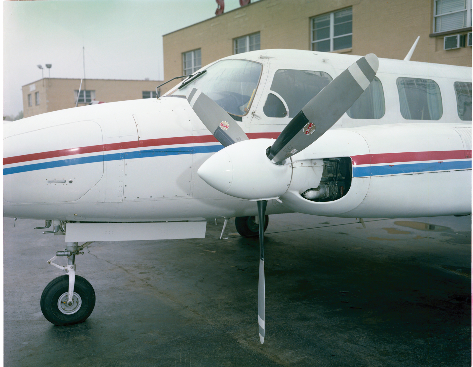 LEFT NACELLE AND PROPELLER OF THE BEECHCRAFT TWIN BONANZA AIRPLANE OWNED BY THE MOHICAN AIR SERVICE