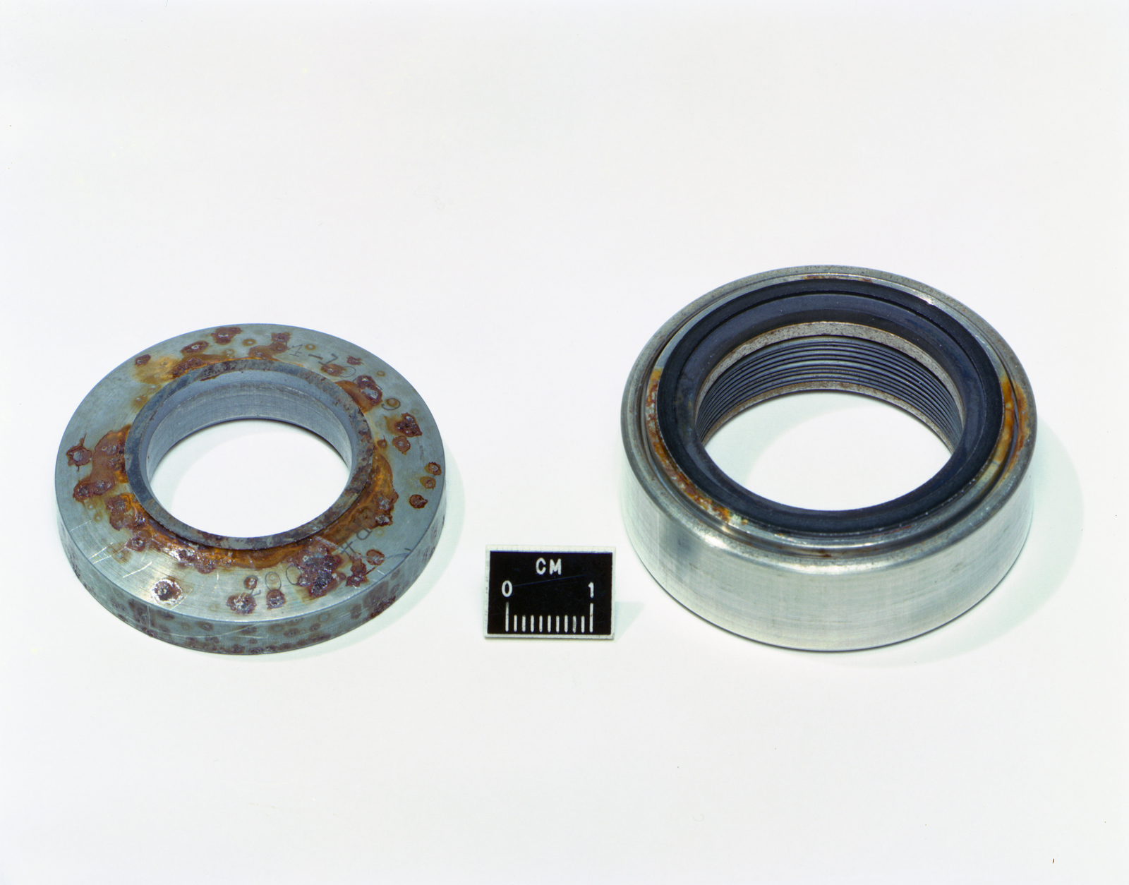 LIQUID OXYGEN LOX BOOST PUMP SEAL SHOWING RUST ON BOTH SIDES