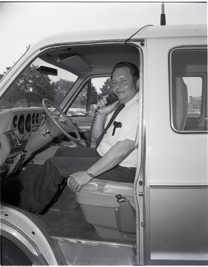 ROY KARABINUS TALKING INTO A CB CITIZENS BAND RADIO IN HIS CAR