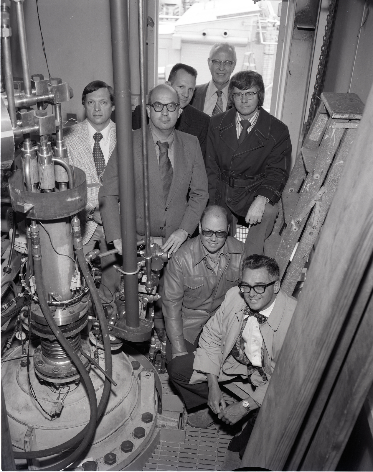 TOM OCILKA PERSONNEL WORKING ON THERMOCOUPLES - FRITZ KRAUSE PERSONNEL WORKING ON PIPING - BOB ROBINSON PERSONNEL WORKING ON INSTRUMENTATION - DESIGNERS POSING IN FRONT OF CELL 13 OLD ROCKET LABORATORY ORL WITH JIM KEATON - JOE RICHALSKY -