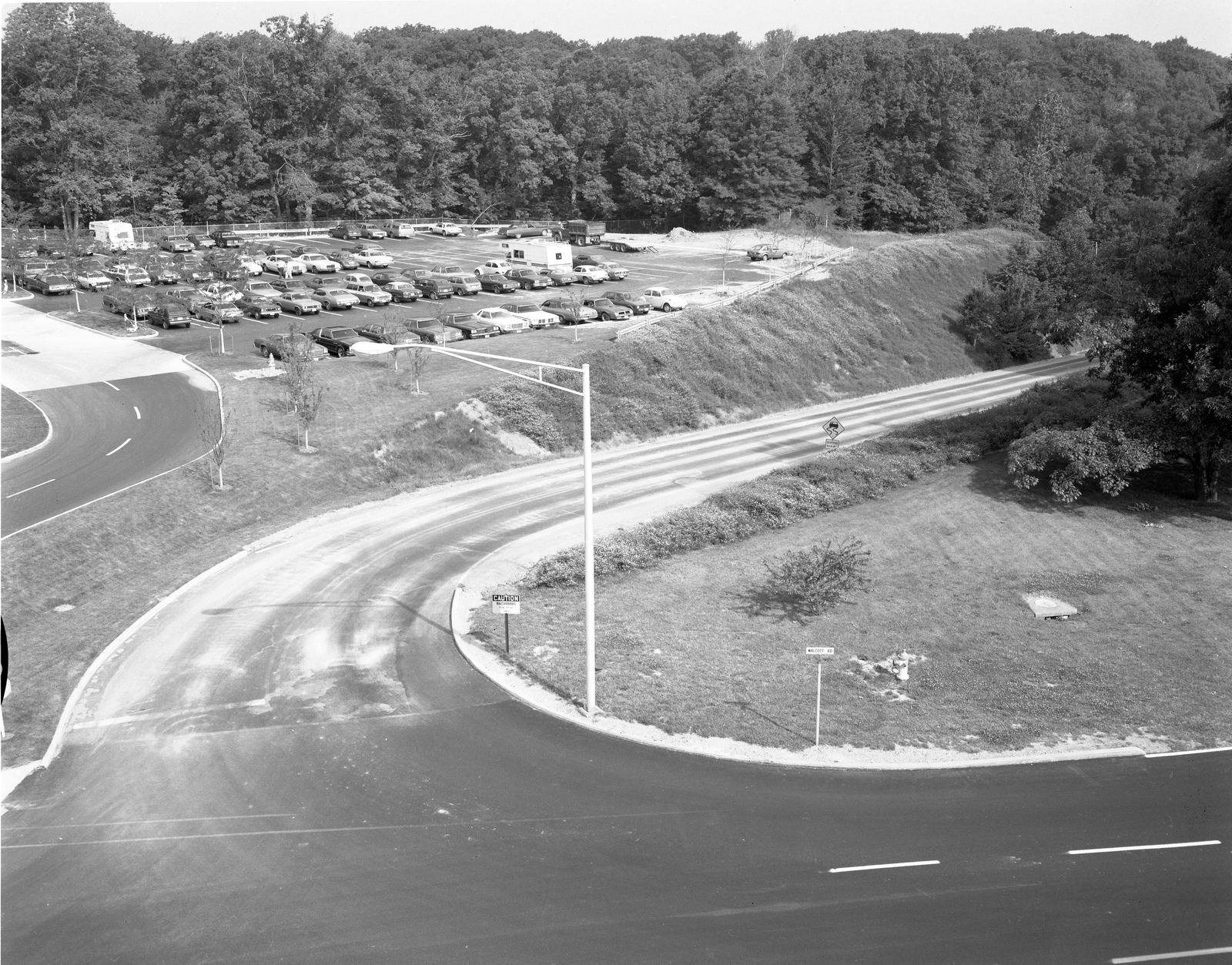 WALCOTT ROAD FROM WIGGINS FUEL STORAGE TANK FARMS TO THE SOUTH GATE HOUSE BUILDING