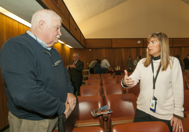 Aberdeen, N.J., Nov. 20, 2012 -- Edie Lohmann, FEMA National Flood Insurance Program specialist, talks to a Mayoral representative at a Congressional hearing in Monmouth County, N.J. held  by Congressman Frank Pallone, D-NJ.  FEMA brought various specialist to the meeting to provide information about the various programs that towns may be eligible for