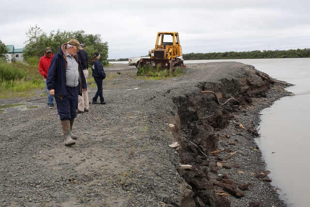 Alakanuk, Alaska, July 16, 2013 -- The Alakanuk City Manager James Blowe inspects the heavily eroded river bank of the Yukon after severe flooding devastated the community. Federal funding in the form of Public Assistance (PA) is available to state, tribal and eligible local governments and certain nonprofit organizations on a cost sharing basis for emergency work and the repair or replacement of facilities damaged by the flooding in the Alaska Gateway Regional Educational Attendance Area (REAA), Copper River REAA, Lower Yukon REAA, Yukon Flats REAA, and the Yukon-Koyukuk REAA. Adam DuBrowa/ FEMA