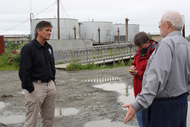 Alakanuk, Alaska, July 16, 2013 -- The Alaska State Coordinating Officer Sam Walton (C) and Federal Coordinating Officer Dolph A. Diemont (L) tour with City Manager James Blowe (R) and discuss the FEMA programs which will assist in the recovery efforts after severe flooding destroyed their tank system. Federal funding in the form of Public Assistance (PA) is available to state, tribal and eligible local governments and certain nonprofit organizations on a cost sharing basis for emergency work and the repair or replacement of facilities damaged by the flooding in the Alaska Gateway Regional Educational Attendance Area (REAA), Copper River REAA, Lower Yukon REAA, Yukon Flats REAA, and the Yukon-Koyukuk REAA. Adam DuBrowa/ FEMA