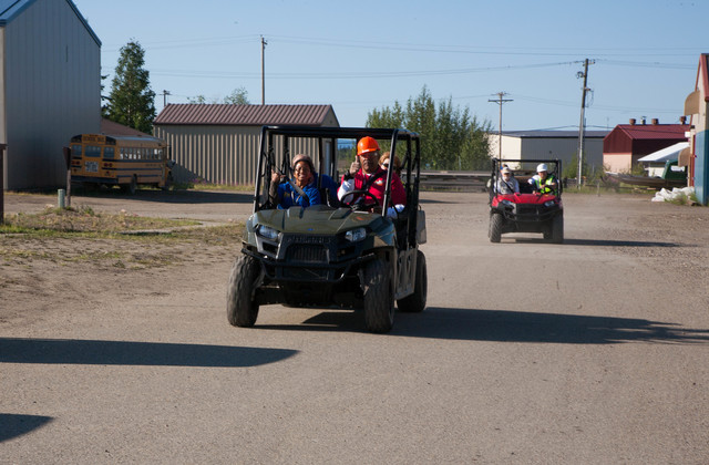 Anchorage, Alaska, July 12, 2013 -- Otis McDaniel takes the lead four wheeler and gives recovery workers a ride to the air port. Four wheelers are basic transportation in the Alaska villages, Photo by Ed Edahl/FEMA