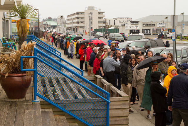 Asbury Park, N.J., May 28, 2013 -- A line of people stretching almost two blocks, wait patiently in the rain for a chance to see President Obama at the Asbury Park Convention Hall. During his speech, Obama cheers the strength of the Jersey Shore and its people. Rosanna Arias/FEMA