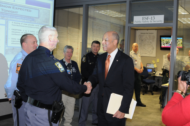 Atlanta, Ga., February 14, 2014 -- At the State Emergency Operations Center(SOC), Homeland Security Secretary Jeh Johnson speaks with Georgia ESF-13 Public Safety and Security officials (l-r) Lt. Col. Russell Powell (GSP); Captain Johnny Jones (MCCD); Captain Soffie Thigpen (GSP); Major Gene Davis (MCCD); Major Stephen Adams (DNR) who are  here in response to the winter storm. Thousands of residents have been affected in the southeast and FEMA and partners can help provide critical recovery services. George Armstrong/FEMA