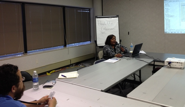 Aurora, Ill., July 23, 2013 --Paulette Coleman conducts a tutorial on online training for FEMA staff deployed in Illinois. FEMA supports educational opportunities and innovative career development for a fully trained workforce. Marquita Hynes/FEMA