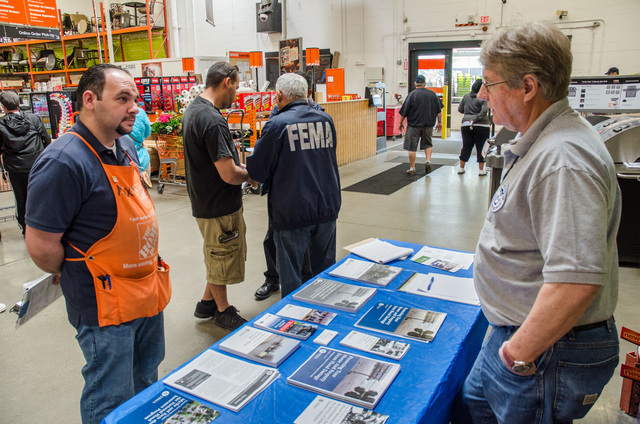 Bay Shore, N.Y., May 18, 2013 -- FEMA Mitigation Outreach Teams are visiting some Lowe's and Home Depot stores in the New York area to offer information on Flood Insurance Rate Maps, repairs and rebuilding. K.C.Wilsey/FEMA
