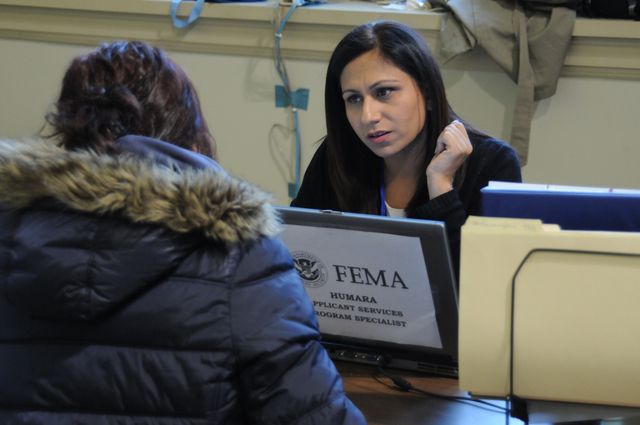 Bayonne, N.J., Dec. 1, 2012 -- At the Hudson County FEMA Disaster Recovery Center (DRC) on it's first day of operation, FEMA Applicant Services Program Specialist Humra Ahmed speaks with a potential applicant. DRC's provide many disaster services at one location.  George Armstrong/FEMA
