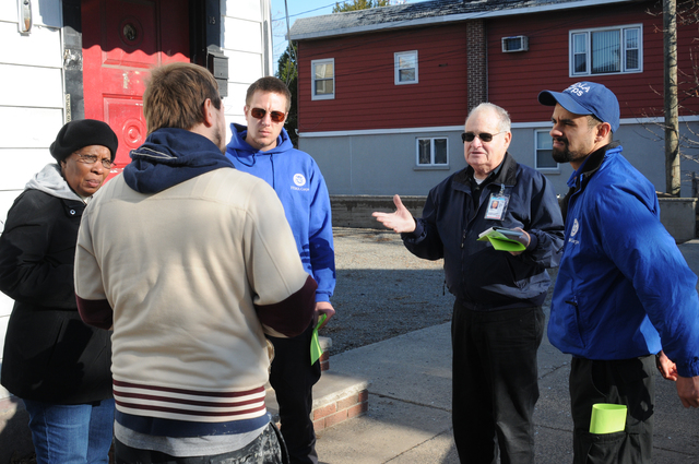 Bayonne, N.J., Nov. 26, 2012 -- This FEMA Community Relations (CR) Outreach Team (FEMA CR Team Lead Mike Dunn, FEMA CR Specialist Juanita Manley, FEMA Corps members Dane Gelllerup and Saul Korzenecki) speak with a Hurricane Sandy survivor during their door-to-door outreach to inform survivors of available disaster services. FEMA is here to help eligible individuals and the community recover from this record breaking storm.  George Armstrong/FEMA